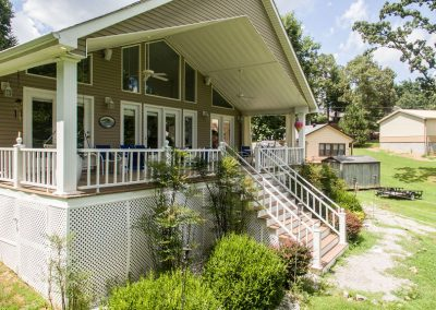 Barefoot Properties | Kentucky Lake Vacation Rentals | Lake Cottage | Lake View | Front Porch Swing