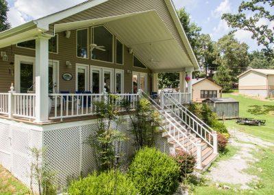 Barefoot Properties | Kentucky Lake Vacation Rentals | Lake Cottage | Lake View | Front Porch Swing